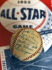 A signed ball includes the signatures of many 1953