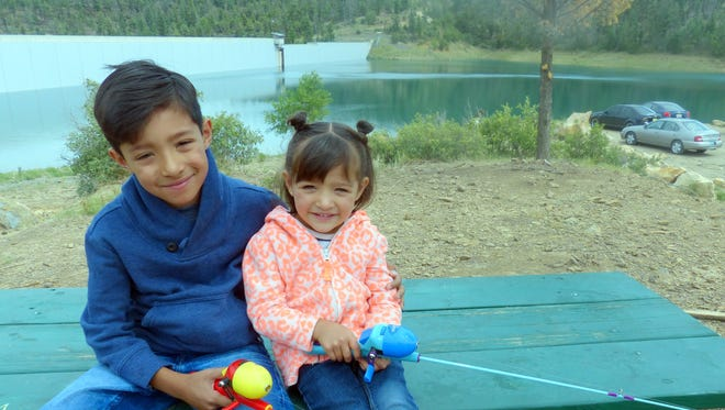 Israel Hernandez, 7, and his younger sister Sam, 3, prepare for Saturday's Kids Fishing Day at Grindstone Reservoir.