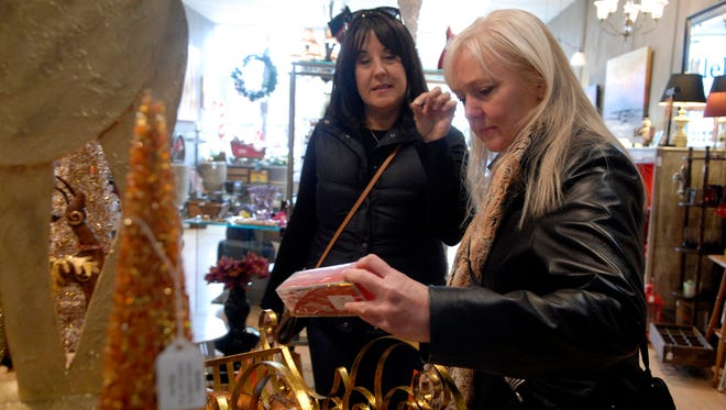 Mitzi Root, left, and Morgan Runner, right, shop for holiday decorations at Rellek  in NuLu on Small Business Saturday.  Nov 29, 2014