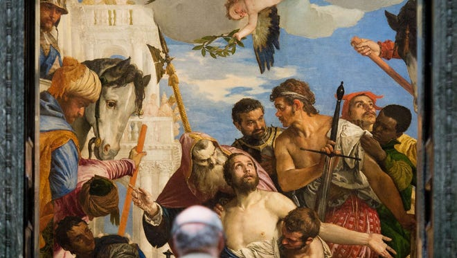 """""""The Martyrdom of Saint George"""" by Paolo Veronese is viewed in March 2014 at an exhibition of his work at the National Gallery in London as part of the exhibit """"Veronese: Magnificence in Renaissance Venice."""""""