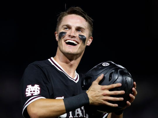 Mississippi State's Jake Mangum (15) celebrates in the ninth inning in Game 2 against Stanford at the NCAA college baseball super regional tournament in Starkville, Miss., Sunday, June 9, 2019. Mississippi State won 8-1, and advance to the College World Series. (AP Photo/Rogelio V. Solis)