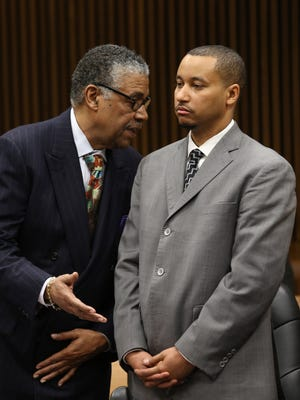 Attorney Godfrey Dillard talks to his client, State Senator Virgil Smith, as he admits guilt and enters a plea deal in front of Wayne County circuit Judge Lawrence Talon. Smith will relinquish his position as a senator as he entered a guilty plea deal on Thursday, February 11, 2016.