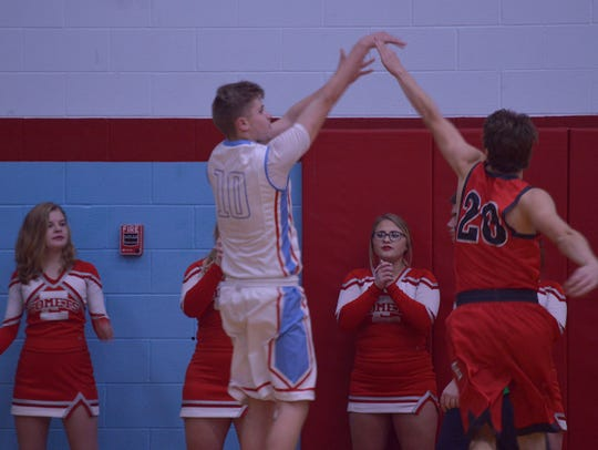 Ridgedale's Sam Leach shoots a jump shot over Elgin's