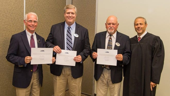 Shown from left are Ron Barden, Barry Roberts, Mitchel Barrett and Judge Chan Caudell.