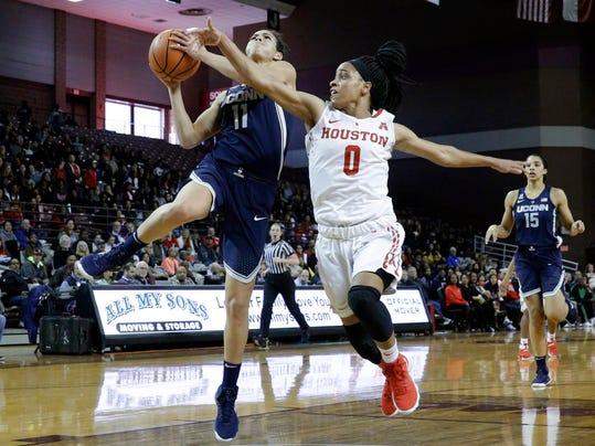 Connecticut guard Kia Nurse (11) puts up a shot past Houston guard Angela Harris (0) during the first half of an NCAA college basketball game Saturday, Jan. 13, 2018, in Houston, Texas. (AP Photo/Michael Wyke)