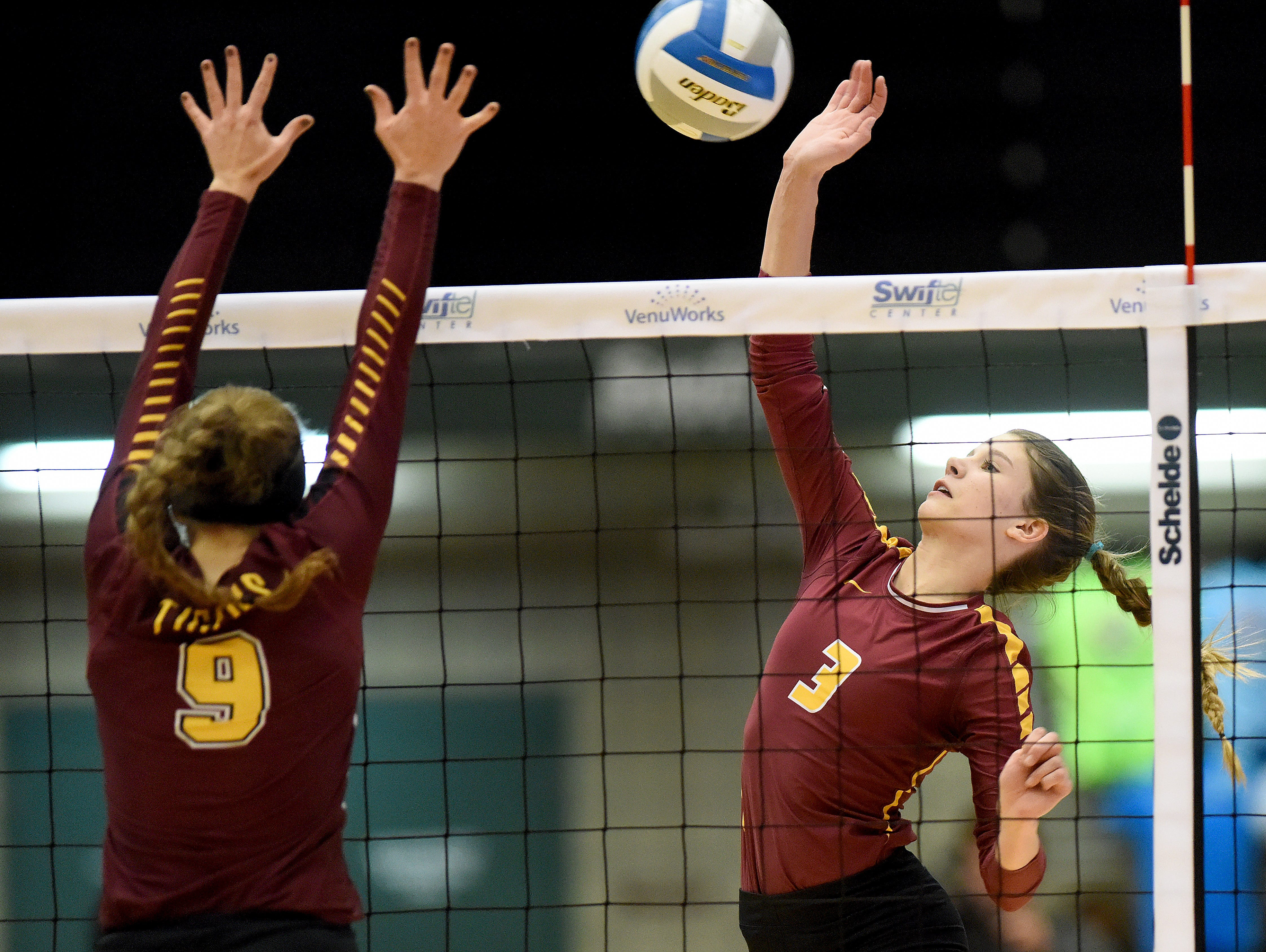 Roosevelt's Mattie Reesman (3) hits the ball while Harrisburg's Avery Thorson (9) goes up for a block during the S.D. State AA Volleyball championship at the Swiftel Center in Brookings.