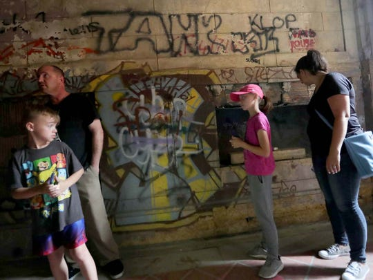 People touring Michigan Central Station in Detroit