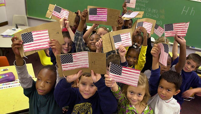 First-grade students at the Pennington-Grimes Elementary School in Mount Vernon, decorated paper bags with American flags that were given to rescue workers at Ground Zero. Nowadays, teachers struggle to teach the events of Sept. 11 to a generation of students who had not yet been born.