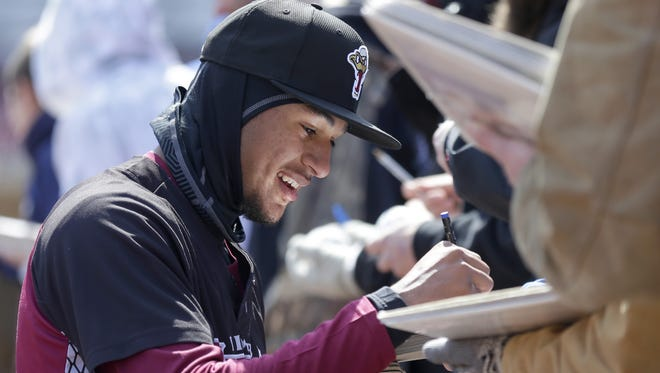 Jake Gatewood signs an autograph during a previous FanFest at Fox Cities Stadium in Grand Chute. This year's edition, set for Tuesday, has been canceled due to expected bad weather.