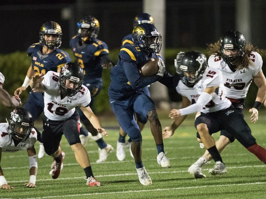 D'Andre St. Jean of Naples returns kick in the second half of the game against Port Charlotte at Naples High Friday night, November 10, 2017.