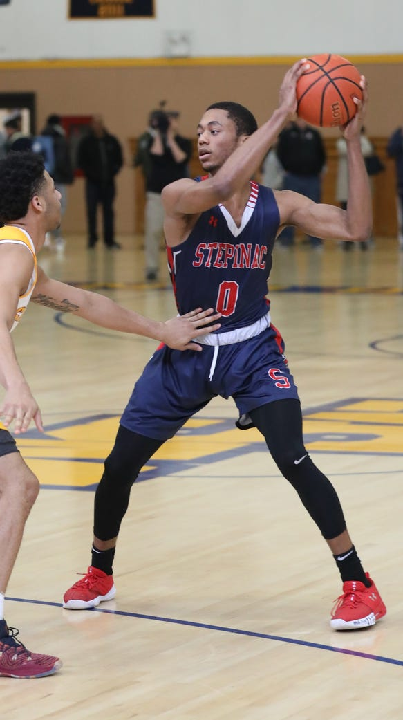 Archbishop Stepinac's Alan Griffin looks for an opening