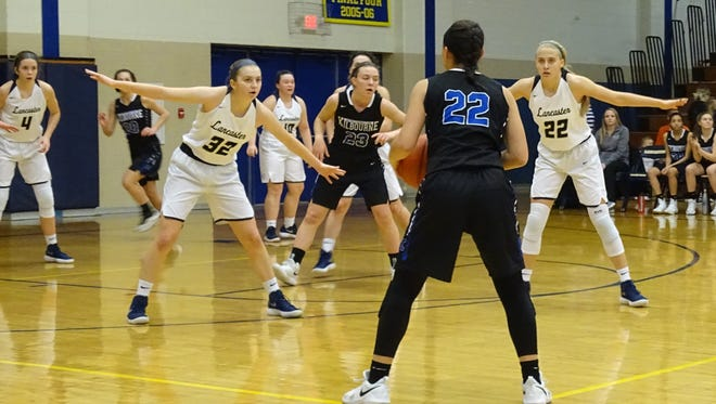 Lancaster's Lauren Frick and Anna Hartigin the Golden Gales' 2-2-1 zone defense, helped lead the Gales to a 43-33 Division I first-round tournament win over Worthington Kilbourne.