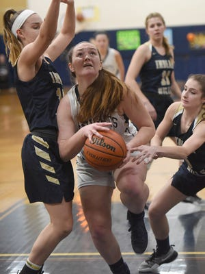 NV/Old Tappan's Sophie Downey drives toward the basket for a shot in the Golden Knights' 54-52 win over Indian Hills on Tuesday.