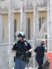 An El Paso police officer guards the Fred Wilson Avenue