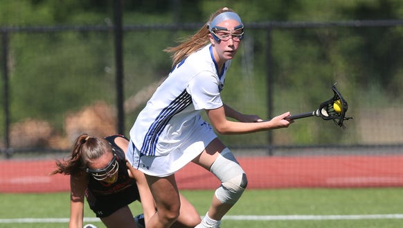 Bronxville's Fiona Jones (15) drives to the goal against