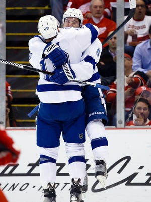 Tampa Bay Lightning center Tyler Johnson (9) receives congratulations from left wing Ondrej Palat (18) after scoring in the second period against the Detroit Red Wings.