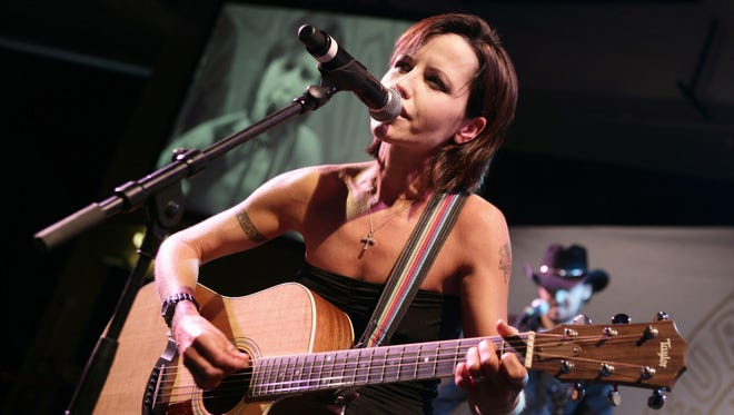 In this Jan. 27, 2008 file photo, Cranberries lead singer Dolores O'Riordan performs during the European Border Breakers awards, or EBBA awards, in Cannes, southern France. O'Riordan, lead singer of Irish band The Cranberries died on Jan. 15, 2018. She was 46.