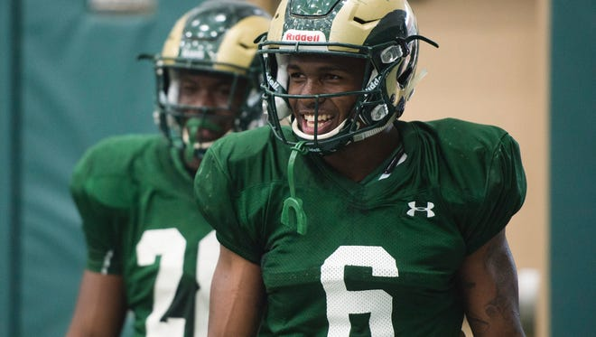 CSU running backs Darius May (6) and Rashaad Boddie, shown waiting their turn to run a drill in practice last spring, are waiting to see more carries in games this fall while playing behind Dalyn Dawkins, Izzy Matthews and Marvin Kinsey Jr.