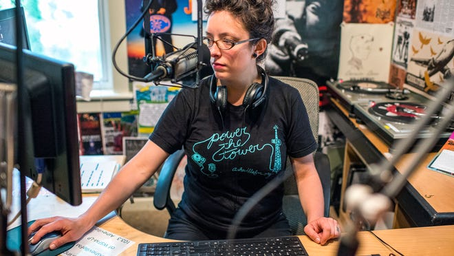 Kim Roney, station manager at Asheville FM, sits in the West Asheville studio Tuesday.