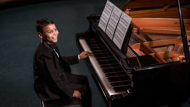 Diego Adams plays piano one-handed due to partial paralysis resulting from cerebral palsy.