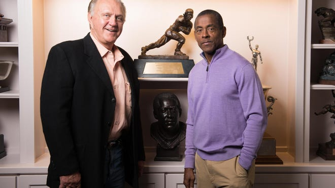 Jackie Sherrill, left, and Tony Dorsett -- and Dorsett's Heisman Trophy -- have a friendship that goes back more than 40 years.