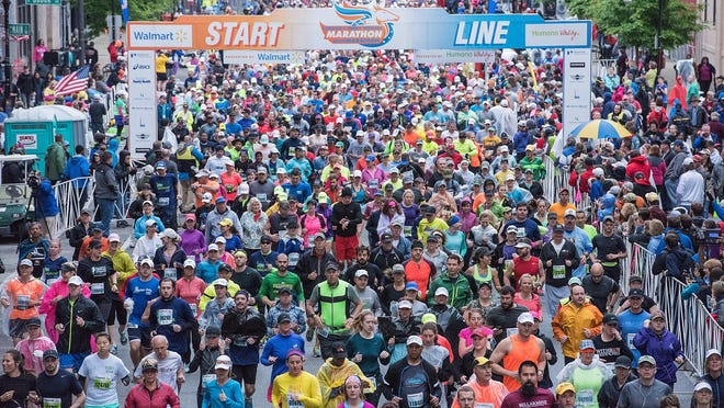 Runners begin the 2015 Kentucky Derby Festival mini/Marathon presented by Walmart and HumanVitality on Main Street in downtown Louisville.