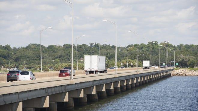 Drivers coming off the Pensacola Bay Bridge into Pensacola.