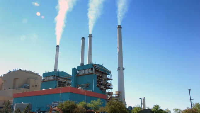 The Colstrip Steam Electric Station, a coal-burning power plant in Colstrip, Mont., is seen in 2013. Most Americans would be willing to pay a little more each month to fight global warming, but only a tiny bit, according to a new poll. Still environmental policy experts hail that as a hopeful sign.