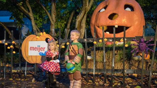"""photos by Brian Bohannon/Special to CJKinley Gentry, 2, and her brother Carter Gentry, 4, are photographed in front of Mumpkin the Giant Talking Pumpkin at """"The World's Largest Halloween Party"""" last October at the Louisville Zoo. Kinley Gentry, 2, and her brother Carter Gentry, 4 are photographed in front of Mumpkin the Giant Talking Pumpkin at """"The World's Largest Halloween Party"""" at the Louisville Zoo. Oct. 24, 2015"""