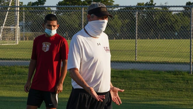 Coach Giles Roberts holds soccer workouts Tuesday morning at Ashley High School. After several seasons away, Roberts is back on the sideline with the Screaming Eagles for a 2020 season everyone hopes is played despite the COVID-19 pandemic.