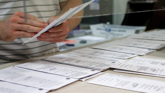 FILE - In this May 28, 2020, file photo, Butler County election worker is processing mail-in ballots for the Pennsylvania Primary election.