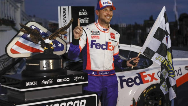 Denny Hamlin celebrates after winning the NASCAR Cup Series auto race at Pocono Raceway, Sunday, June 28, 2020, in Long Pond, Pa.