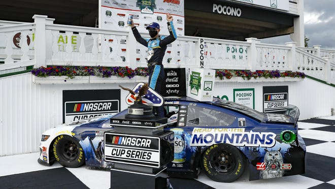 Kevin Harvick celebrates in the winners circle after winning the NASCAR Cup Series race at Pocono Raceway on Saturday, June 27, 2020, in Long Pond, Pa.