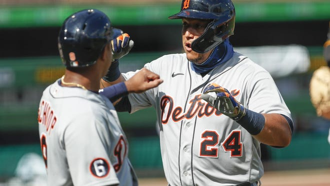 Detroit Tigers' Miguel Cabrera, right celebrates with Jonathan Schoop after driving him in with a two run home run in the first inning of a baseball game against the Pittsburgh Pirates, Saturday, Aug. 8, 2020, in Pittsburgh. This was the second of four home run Pirates starter Derek Holland gave in the Tigers five run first.