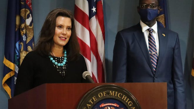 """In this photo provided by the Michigan Office of the Governor, Gov. Gretchen Whitmer addresses the state during a speech in Lansing, Mich., Thursday, Sept. 10, 2020. Whitmer on Thursday sharply criticized President Donald Trump following revelations that he had purposely downplayed the deadly coronavirus, calling it """"devastating"""" news and Trump the """"biggest threat"""" to Americans."""
