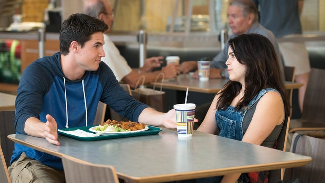"Robbie Amell and Mae Whitman in ""The DUFF."""