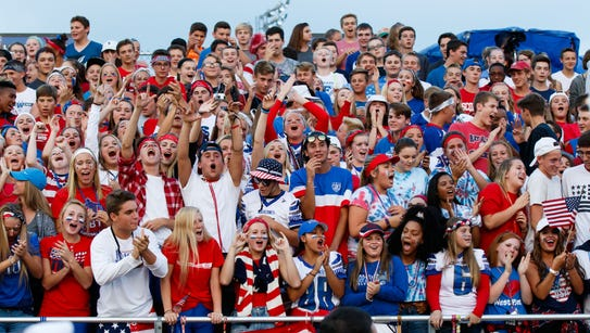 Waukesha West fans cheer on their team during the game