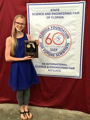 "Annalisse VanZanten from Fort Myers Christian won in the engineering division for; ""What Factors Affect Pinewood Derby Car Speeds?"""