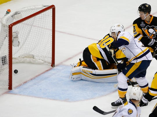 Nashville Predators' Frederick Gaudreau, right, watches his goal against Pittsburgh Penguins' goalie Matt Murray (30) during the third period in Game 1 of the NHL hockey Stanley Cup Finals, Monday, May 29, 2017, in Pittsburgh. (AP Photo/Gene J. Puskar)
