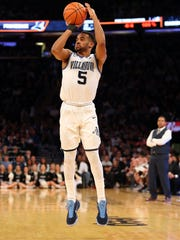 Villanova guard Phil Booth shoots against Providence