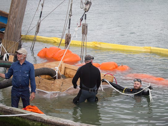 Crews prepare the La Niña before raising it from the bottom of the bay Monday, Dec. 4, 2017, at Lawrence Street T-head. The replica Colombus ship sank when Hurricane Harvey struck Corpus Christi in late August.