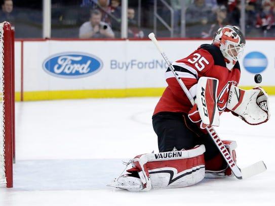 New Jersey Devils goalie Cory Schneider blocks a shot