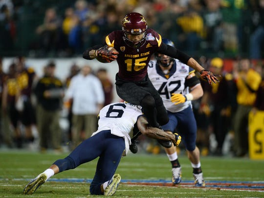 West Virginia safety Dravon Askew-Henry tackles Arizona State wide receiver Devin Lucien. Lucien could be a late-round sleeper target for the Bengals.