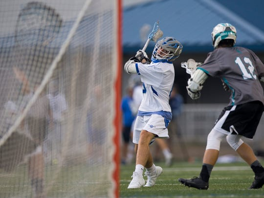 Barron Collier's Jacob Kuhlman gears up for a shot during the first half of a first-round play-in game at Barron Collier High School Thursday, April 13, 2017 in Naples. Barron Collier led 5-4 at the half.