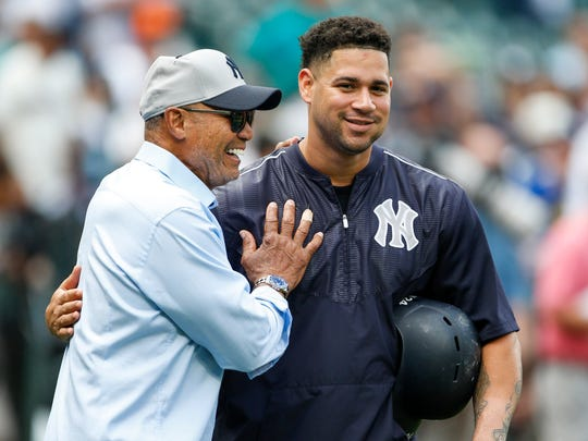 Jul 21, 2017; Seattle, WA, USA; New York Yankees catcher Gary Sanchez (right) greets former Yankee player Reggie Jackson during batting practice before a game against the Seattle Mariners at Safeco Field.