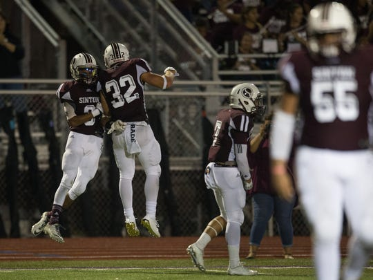 Sinton's Tristan Canales celebrates after making a touchdown during the fourth quarter of their game against Rockport-Fulton at Pirates Stadium in Sinton on Friday, Sept. 8, 2017.