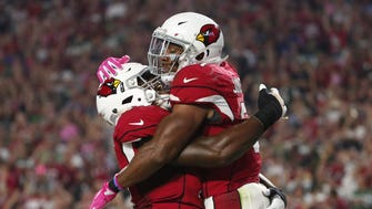 Arizona Cardinals running back David Johnson (31) celebrates his touchdown with offensive tackle D.J. Humphries (74) against the New York Jets during the second quarter at University of Phoenix Stadium during Monday Night Football in Glendale, Ariz. October 17, 2016.