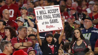 An Arizona Cardinals holds a sign against the Seattle Seahawks at University of Phoenix Stadium in Glendale, Ariz. October 23, 2016.