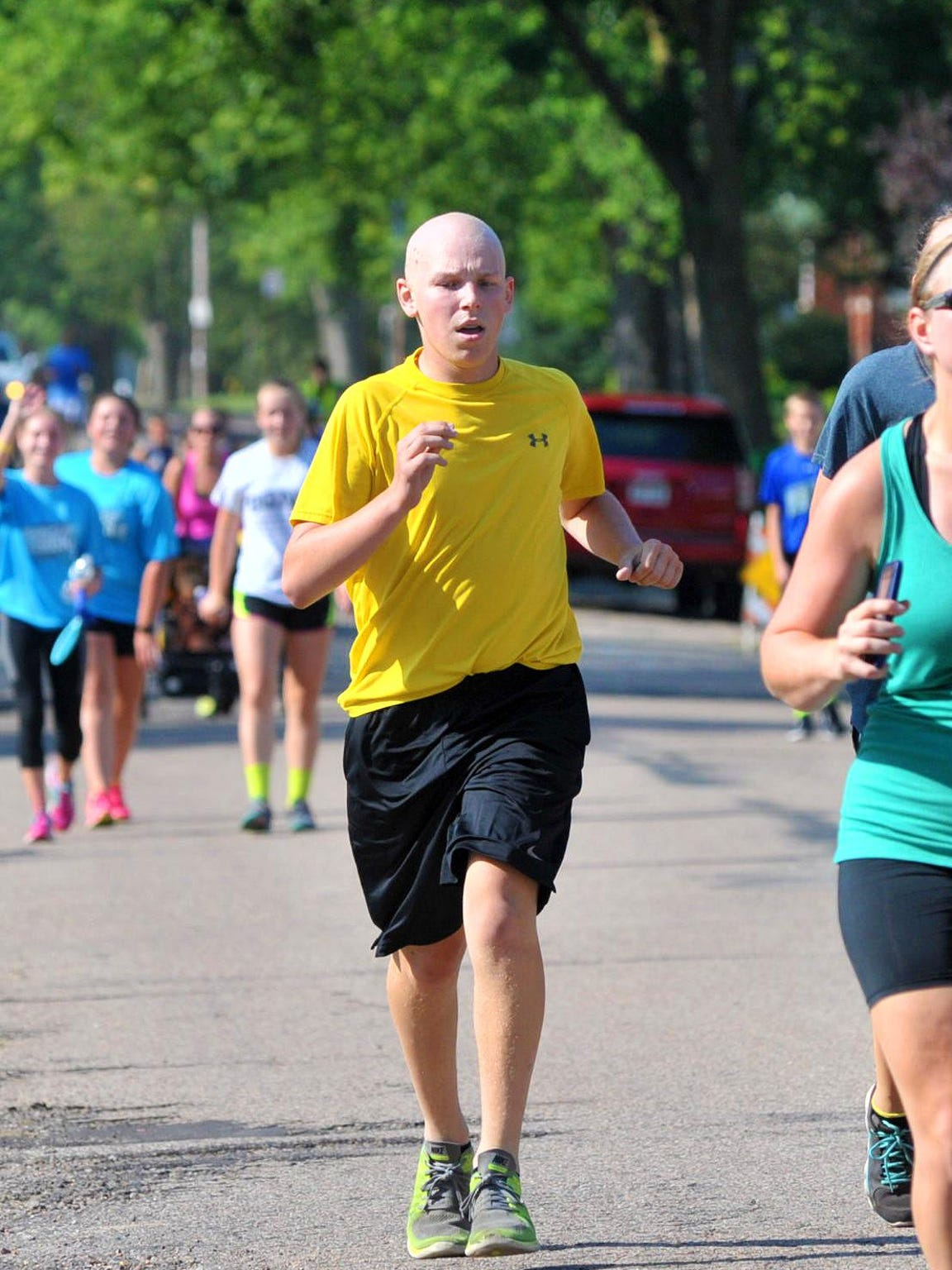 Ryan Dieringer, of Marshfield, runs Saturday during the Nutz Deep run fundraising event in Marshfield this summer.