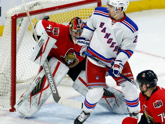 93646185c6b Ottawa Senators Craig Anderson watches as the puck goes off his shoulder as New  York Rangers